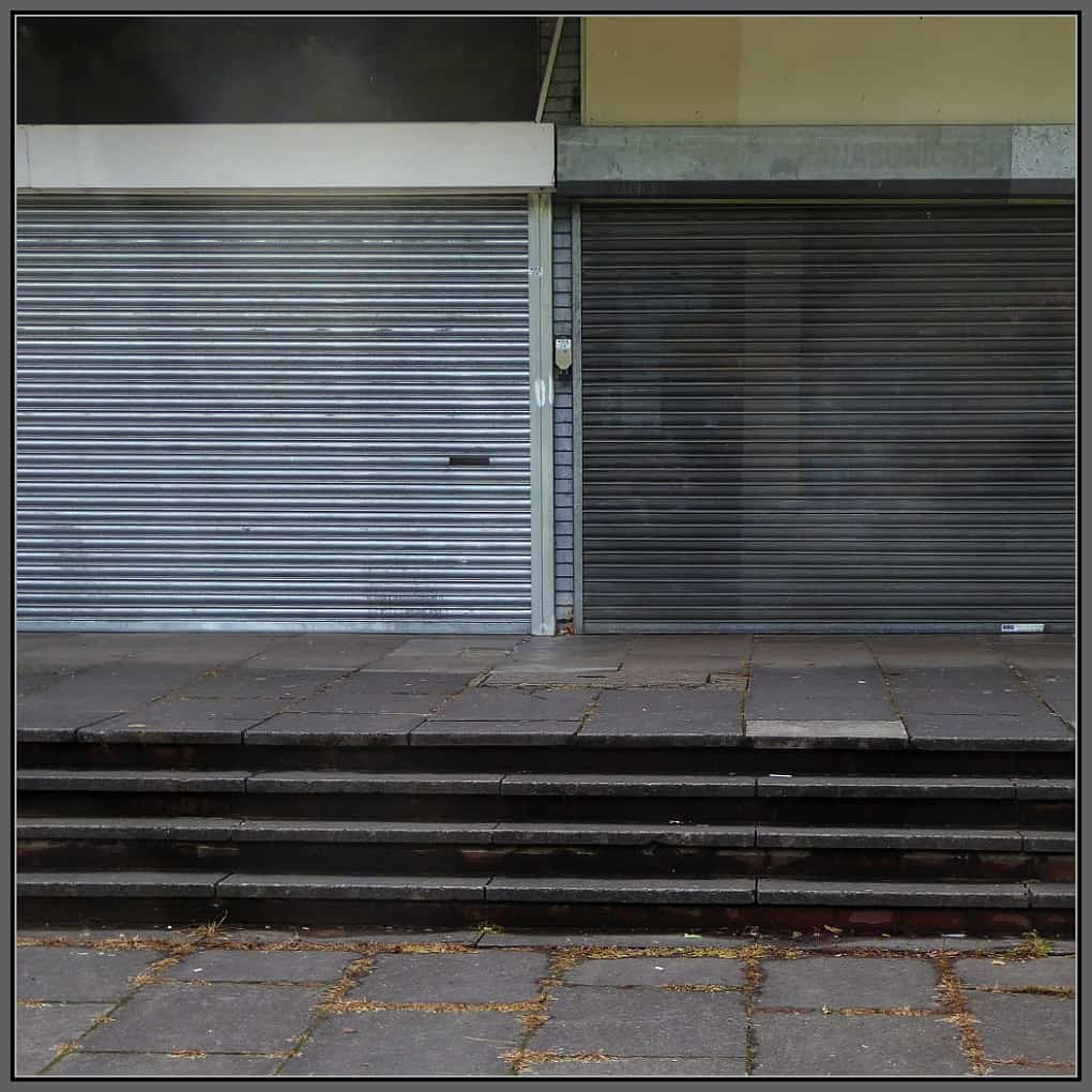 Shop fronts - shut up and closed for business.