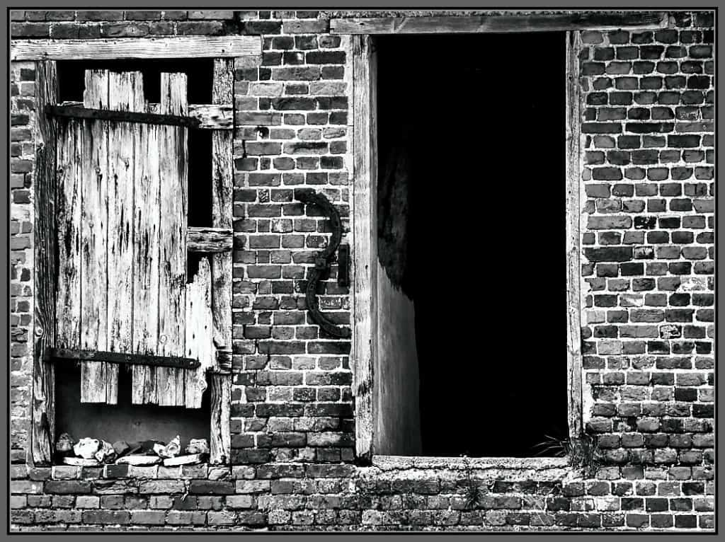 An old wooden door and crumbling brickwork - a Rumination photo