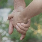 Holding hands - thumbnail image