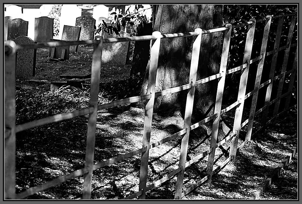 Black and White photo: church yard and graves