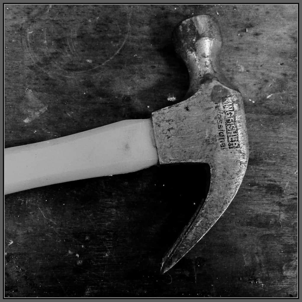 Black and white photo of a hammer head - used but working.