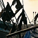 Thumbnail: wreckage and flags