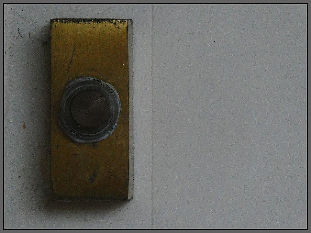 A well-worn bell-push