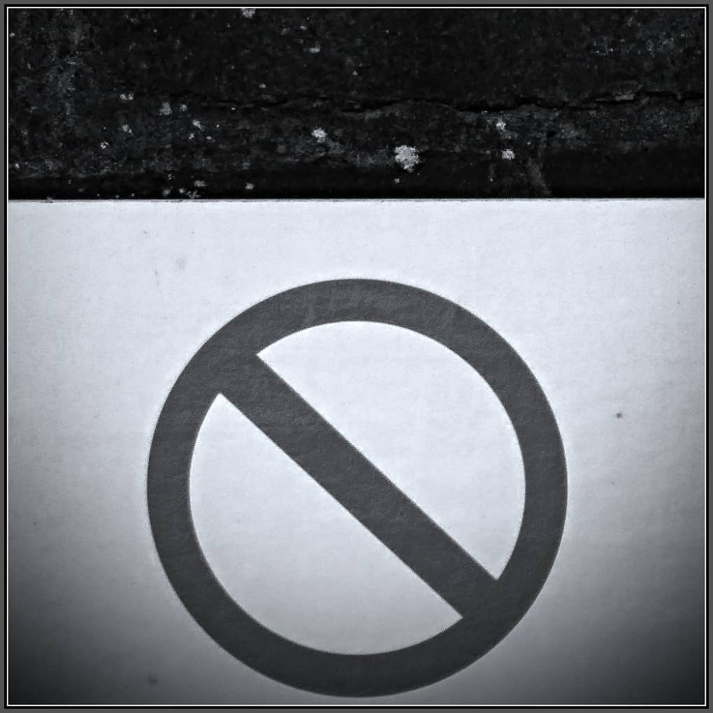 A black and white prohibited sign
